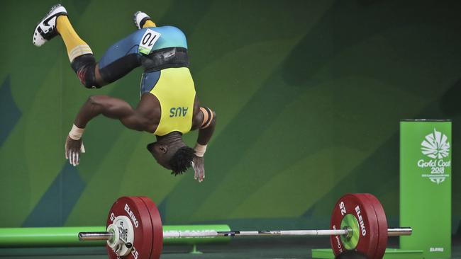 Francois Etoundi performs a celebratory backflip on his way to bronze for Australia on the Gold Coast. He fled the Cameroon team at the 2006 Melbourne Commonwealth Games. Picture: AP/Manish Swarup