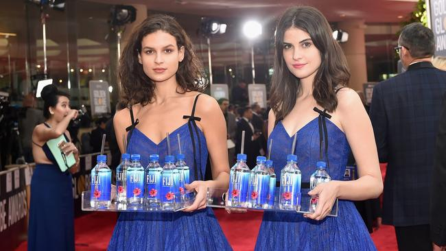 Cuthbert (right) was working as a promotional model for Fiji Water. Picture: Stefanie Keenan/Getty Images for Fiji Water