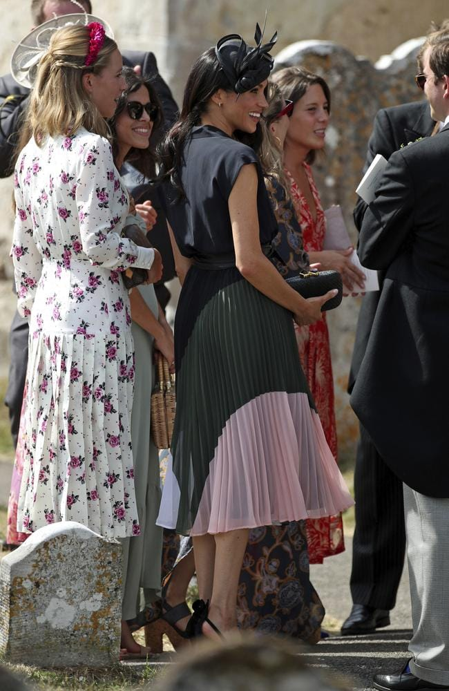 Meghan wore a long pleated skirt in bold block colours teamed with a short-sleeved navy top. Picture: AP