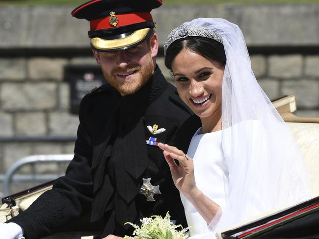 Prince Harry, Duke of Sussex and his wife Meghan Markle, Duchess of Sussex on their wedding day in May, which Thomas skipped out on over health concerns. Picture: Paul Ellis/pool photo via AP