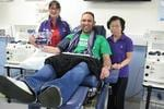 Staff at the Red Cross Blood Service get dressed for #purplefriday.