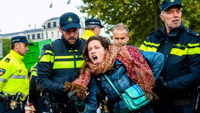 Police arrest an activist in Amsterdam. Photo by Romy Fernandez/AFP