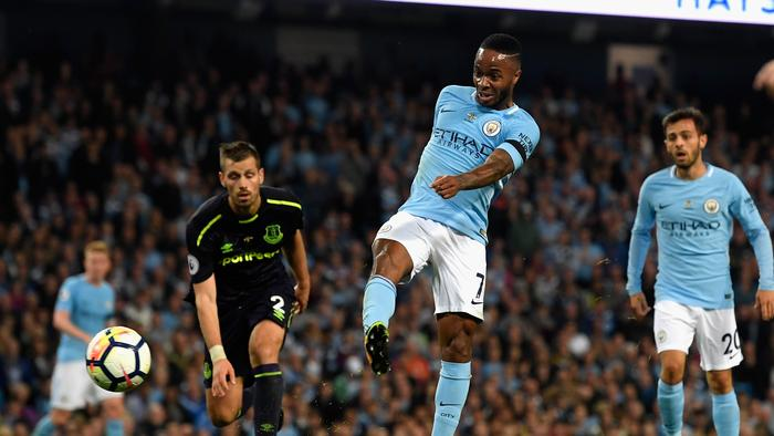 Raheem Sterling of Manchester City scores his side's goal.