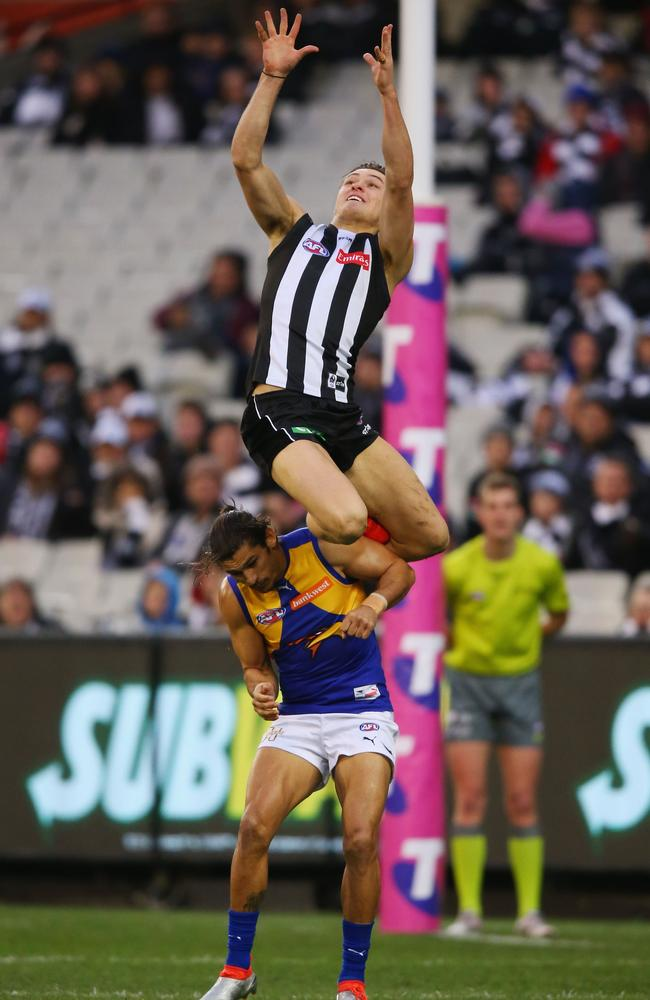 Darcy Moore flies for a high mark.
