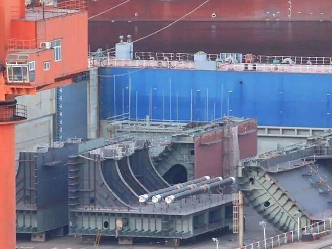 These ship components photographed last year being brought together at the Dalian shipyard are speculated as belonging to China's future third aircraft carrier. Picture: Xinhua