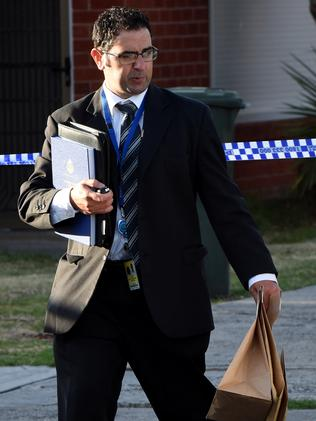 A detective collects evidence at the scene. Picture: Nicole Garmston