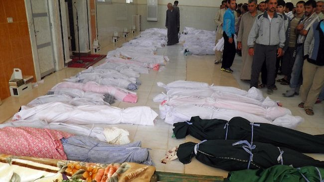 The bodies of some of the 108 people, including 32 children, awaiting burial after a massacre in the Syrian town of Houla at the weekend. Picture: AFP