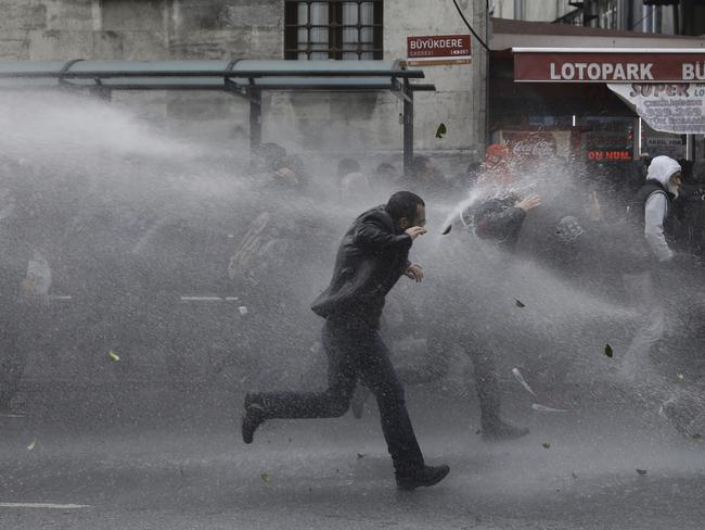 Riot police use water cannons to disperse people protesting the detentions of 12 lawmakers from pro-Kurdish Peoples' Democratic Party, or HDP, in Istanbul on November 5. Picture: AP