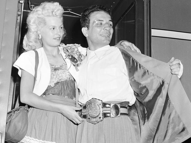 Jake LaMotta with wife Vicky after winning the world title.