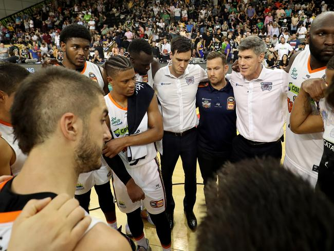 The future is ours: Taipans coach Mike Kelly speaks to his players post match.