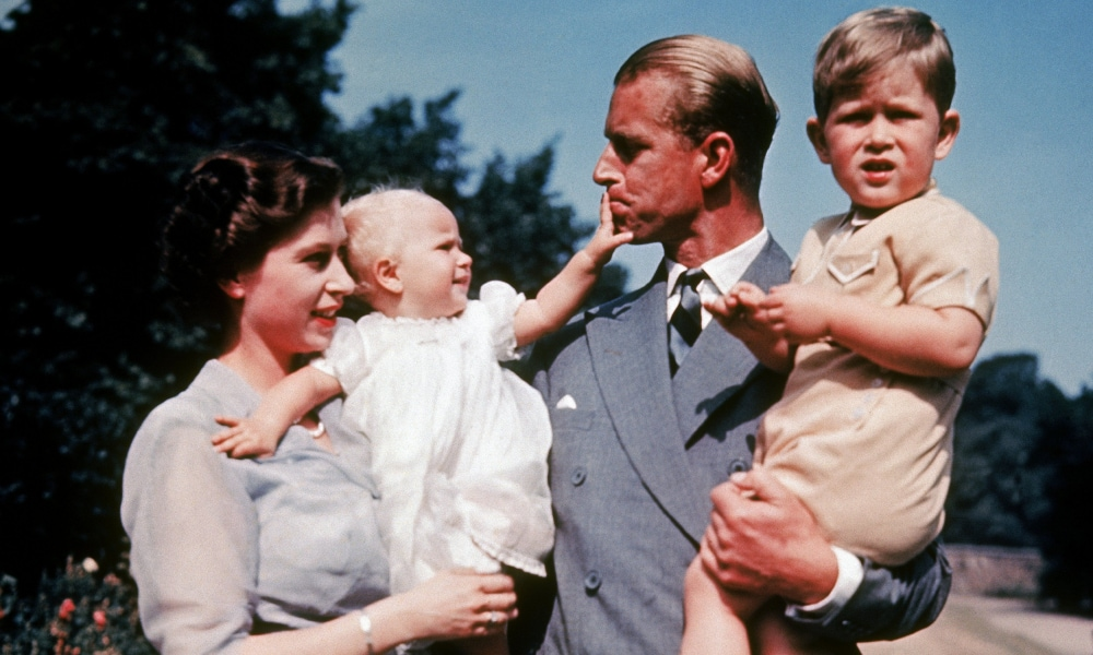 UNITED KINGDOM - JANUARY 01: The first color photograph of Princess ANNE, taken in 1951, in the arms of her mother Queen ELIZABETH II while her father, Philip MOUNTBATTEN, holds her brother Prince CHARLES. (Photo by Keystone-France/Gamma-Keystone via Getty Images)