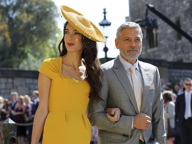 Amal and George Clooney are close friends with Prince Harry. Picture: AP