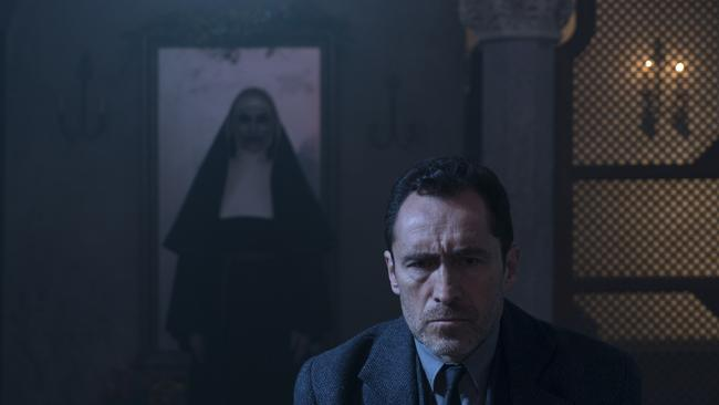 "Bonnie Aarons as The Nun and Demian Bichir as Father Burke in a scene from horror film ""The Nun,"" a Warner Bros. Pictures release."