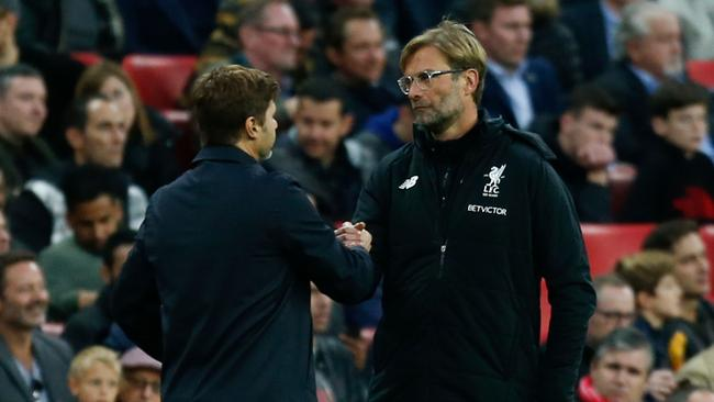 Liverpool's German manager Jurgen Klopp (R) shakes hands with Tottenham Hotspur's Argentinian head coach Mauricio Pochettino.
