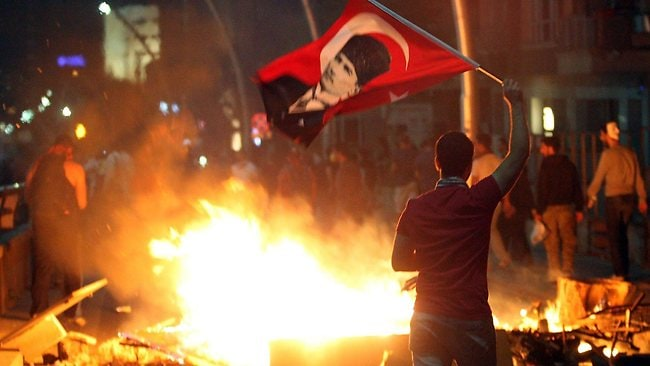An anti-government protester waves Turkey's national flag bearing a portrait of Mustafa Kemal Ataturk, founder of modern Turkey, during a demonstration in Ankara. Picture: AFP