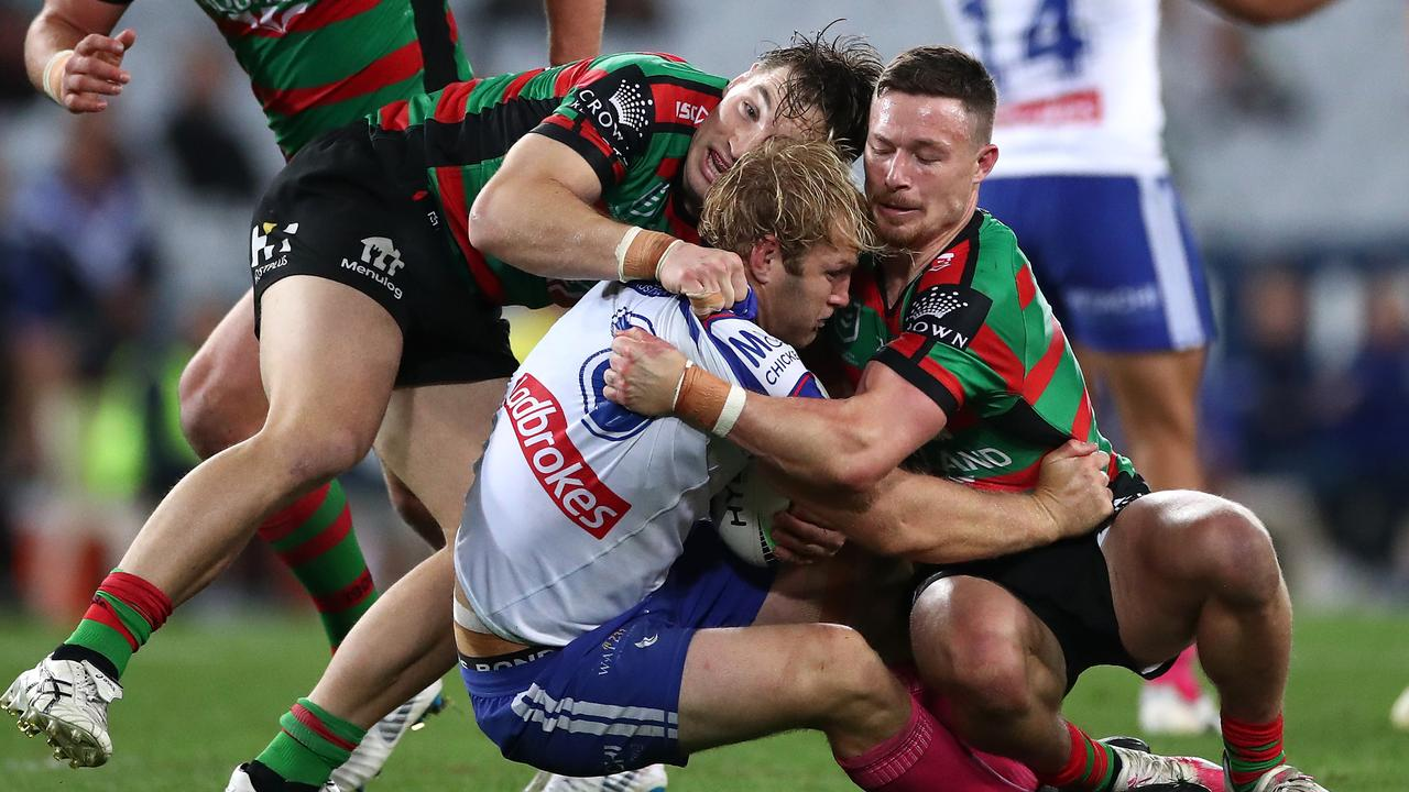 Aiden Tolman is tackled by the Rabbitohs