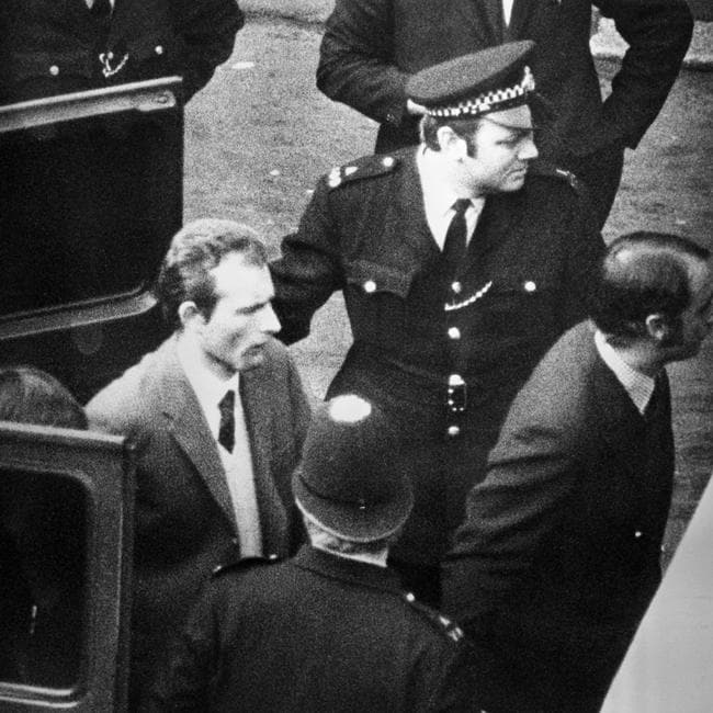Ball is led in handcuffs from a police van to court.