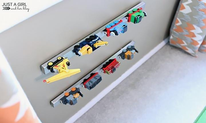 "This hack is so simple, yet so ingenious I can't even handle. They're magnetic knife racks attached to the walls to hold to cars and trains. Amazing!  <a href=""http://justagirlandherblog.com/ikea-big-boy-room-makeover-reveal/"">Picture from Just a Girl and her Blog</a>"