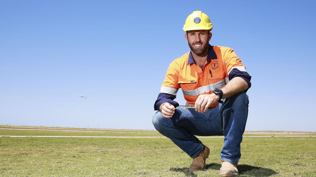 Hugo Struss from Tinamba Turf checks how the grass is growing at Brisbane Airport's second runway. Picture: Claudia Baxter