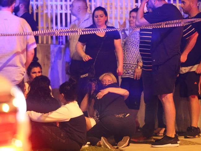 A woman cries at the scene. Picture: Wayne Taylor