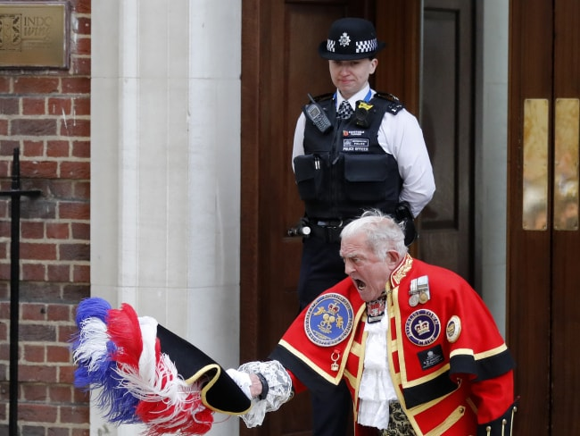 Town Crier Tony Appleton announces that the Duchess of Cambridge has given birth to a baby boy outside the Lindo Wing. Photo: AP/Frank Augstein