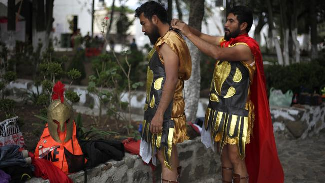 Locals dress as Roman soldiers for a re-enactment in the village of San Mateo. Picture: Marco Ugarte