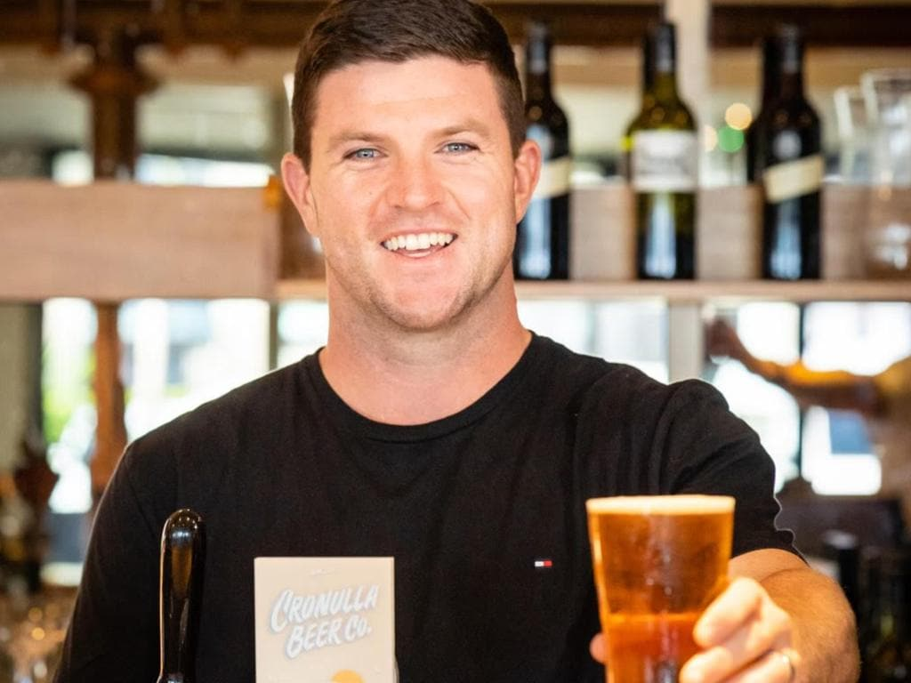 Chad Townsend pours a frosty cold Cronulla Beer Co.