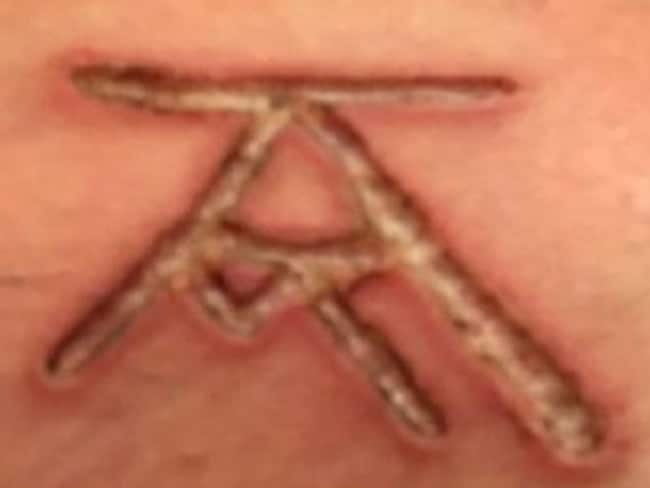 Keith Raniere and Allison Mack's initials (KR and AM) are allegedly seen here. Picture: YouTube