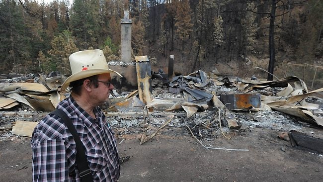 Frank Baker visits the remains of his brother's home which was burnt to the ground in the High Park Fire, June 30, 2012 in Bellvue, Colorado west of Fort Collins. AFP PHOTO / ROBYN BECK