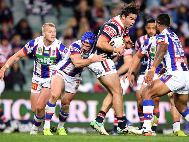 Aidan Guerra of the Roosters is tackled.