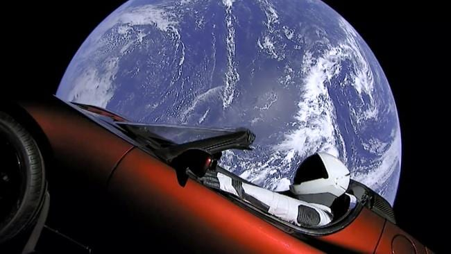 The SpaceX spacesuit in the red Tesla sports car. Picture: SpaceX via AP