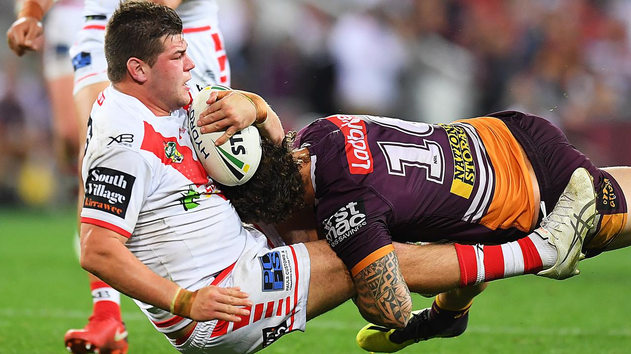 Blake Lawrie is tackled by Korbin Sims in the elimination final.
