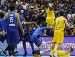The Philippines players, left and Australian basketball players react, during the FIBA World Cup Qualifiers Monday, July 2, 2018 at the Philippine Arena in suburban Bocaue township, Bulacan province north of Manila, Philippines. Australia defeated the Philippines 89-53 via default following a brawl in the third quarter. (AP Photo/Bullit Marquez)