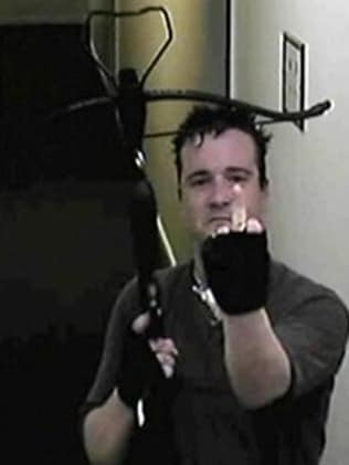 Griffiths gestures to the camera after he kills Ms Blamires.