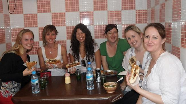 Trying camel burgers with my Intrepid group in Morocco. Picture: Tatyana Leonov