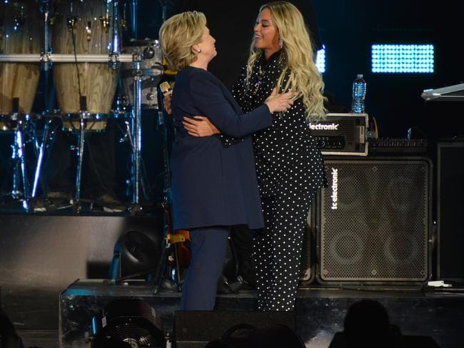 Beyonce welcomes on stage Democratic presidential nominee former Secretary of State Hillary Clinton during a Get Out The Vote concert