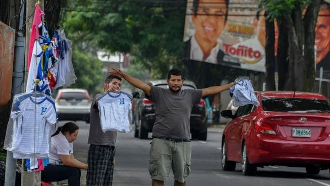 Vendors sell jerseys of the Honduran national football team in the streets of San Pedro Sula,