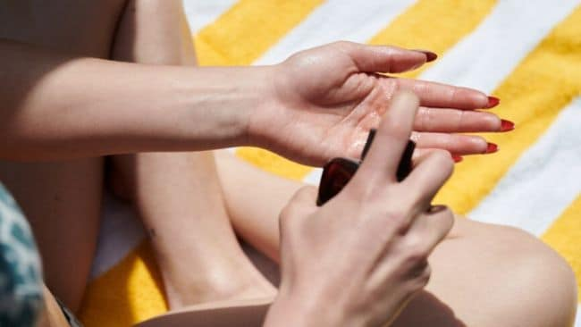 Sunscreens no longer have to mean white, streaky limbs. Image: Stocksy