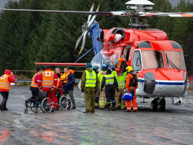 Rescuers wait to assist stranded passengers who were flown by helicopter from the cruise ship Viking Sky in Hustadvika on the west coast of Norway near Romsdal. Picture: NTB/AFP