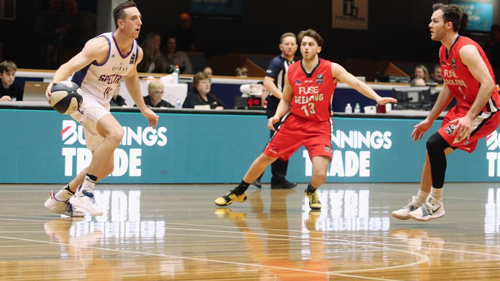 Jordan O'Leary, centre, attempts to stop his Nunawading opponent. Picture: Jacqui Neill