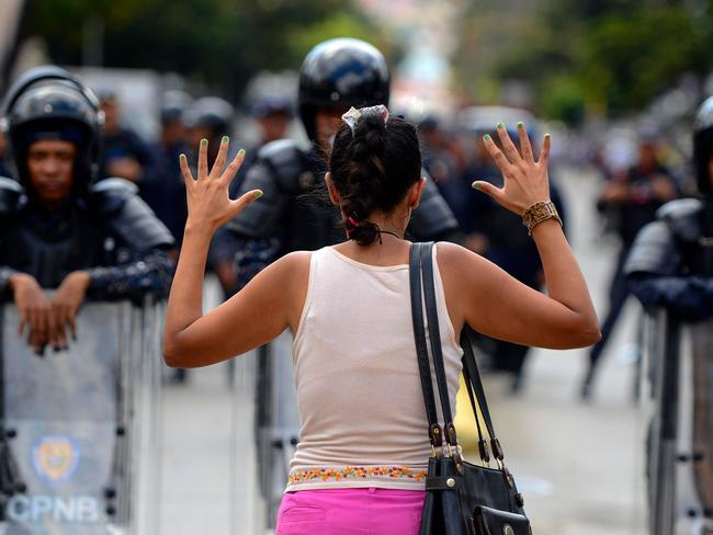 Venezuelan riot police blocked protesters on Saturday as thousands of people took to the streets amid rising tensions. Picture: AFP