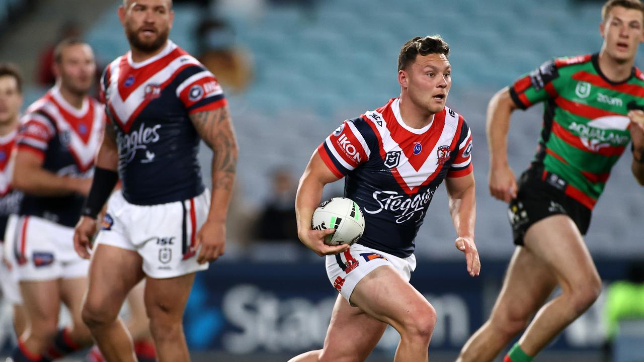 Lachlan Lam makes a run for the Roosters