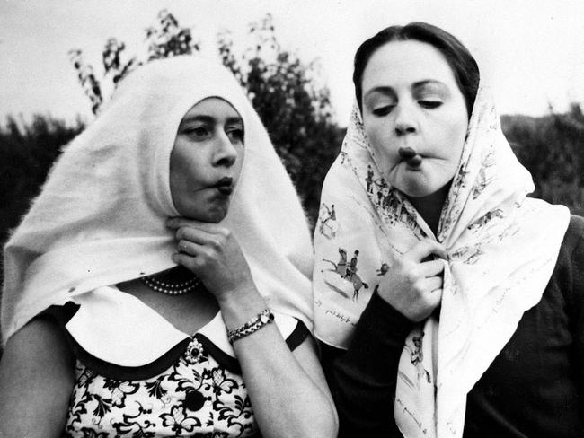 Margaret at left, playing around with a friend in a candid 1957 shot. Picture: Rex/Shutterstock