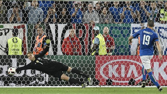 Neuer stops a penalty from Bonucci.