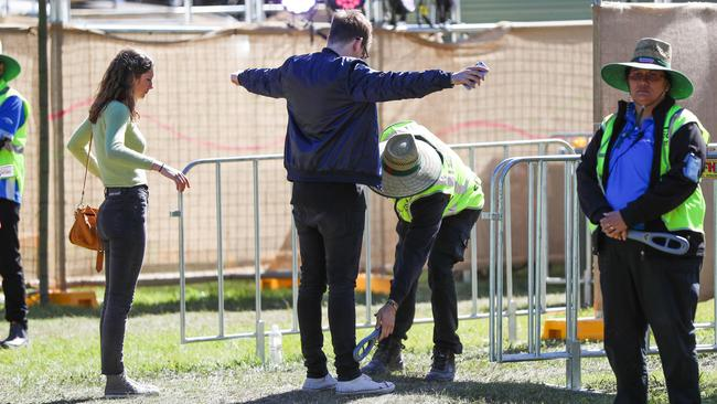 Security searches a patron at the entrance of last year's Splendour in the Grass festival. Picture: Nigel Hallett