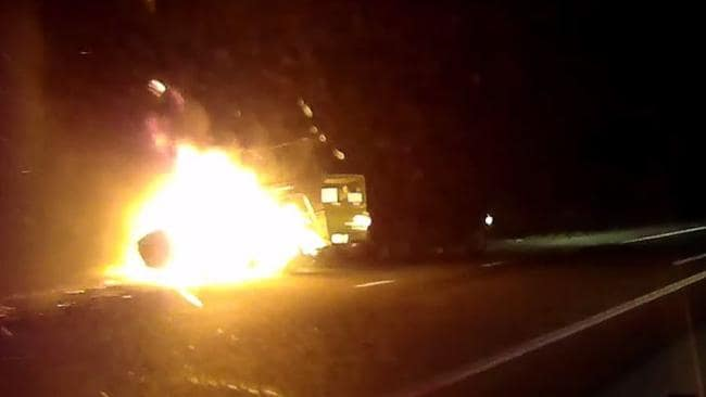 A man finally pulls over for police after towing his fully ablaze trailer down the Bruce Highway. Picture: Queensland Police Service
