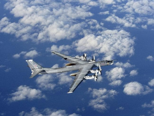 Covert operations ... A Russian military long range bomber aircraft photographed by an intercepting RAF Typhoon. Source: AP