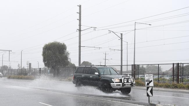 A flooded road in Chelsea, Melbourne. Picture: AAP Image/James Ross.