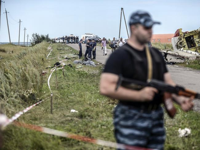 in control ... armed pro-Russian separatists stand guard in front of the crash site of Malaysia Airlines Flight MH17, near the village of Grabove. Picture: Bulent Kilic
