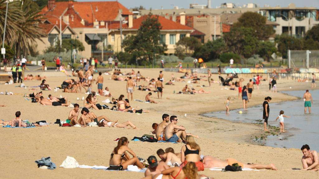 St Kilda beach was packed with sun-seekers on Friday afternoon before police arrived
